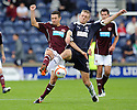 Hearts' Jason Holt and Rovers' Edward Malone challenge for the ball