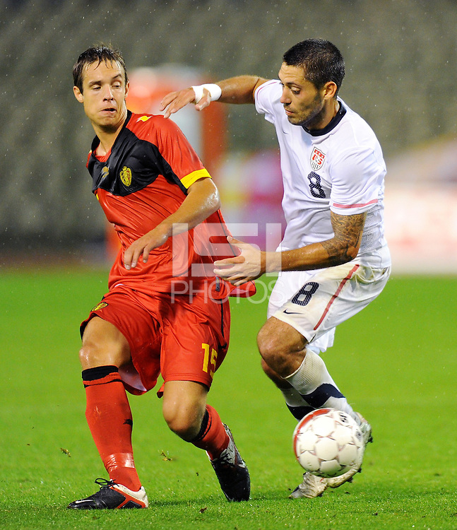 USA's Clint Dempsey (r) and Belgium's David Hubert fight for the ball during the friendly match Belgium vs USA at King Baudoin stadium in Brussels, Belgium on September 06th, 2011.
