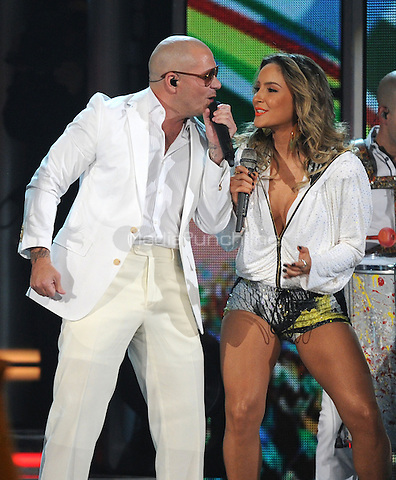 LAS VEGAS, NV - MAY 18: 5 Pitbull and Claudia Leitte perform on the 2014 Billboard Music Awards at the MGM Grand Garden Arena on Sunday, May 18, 2014 in Las Vegas, Nevada. PgMicelotta/MediaPunch