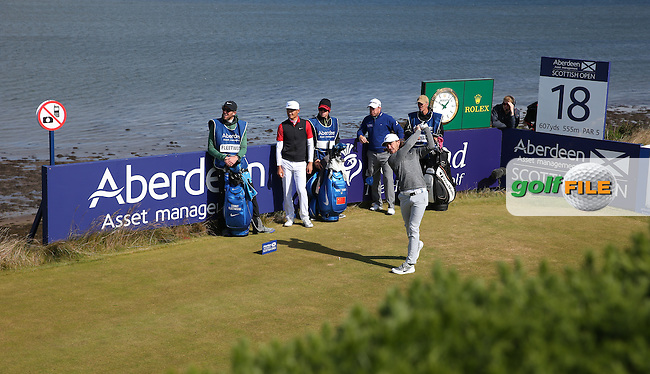 Tommy Fleetwood (ENG) plays from the 18th during the First Round of the 2016 Aberdeen Asset Management Scottish Open, played at Castle Stuart Golf Club, Inverness, Scotland. 07/07/2016. Picture: David Lloyd | Golffile.<br /> <br /> All photos usage must carry mandatory copyright credit (&copy; Golffile | David Lloyd)