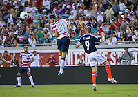 May 26, 2012:  USA Men's National Team d Geoff Cameron (20) heads the ball while being defended by Scotland Kenny Miller (9) during action between the USA and Scotland at EverBank Field in Jacksonville, Florida.  USA defeated Scotland 5-1.............
