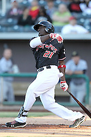 Trayvon Robinson #21 of the Albuquerque Istotopes plays in a Pacific Coast League game against the Omaha Storm Chasers at Isotopes Park on May 3, 2011  in Albuquerque, New Mexico. Photo by:  Bill Mitchell/Four Seam Images.
