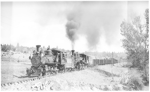 RGS #20 and leased D&amp;RGW #452 with a 33-car train near Pine Ridge.<br /> RGS  Pine Ridge, CO  Taken by Perry, Otto C. - 10/2/1947
