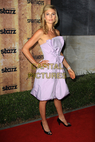 VIVA BIANCA.Starz original TV series 'Spartacus: Blood and Sand' held At The Hammer Museum, Westwood, California, USA..January 14th, 2010.full length purple lilac strapless dress hand on hip black shoes bow sash.CAP/ADM/KB.©Kevan Brooks/AdMedia/Capital Pictures.