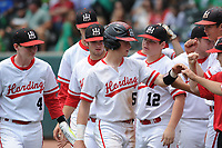 NWA Democrat-Gazette/ANDY SHUPE<br /> Harding Academy shortstop Pate Fullerton (5) is congratulated Friday, May 19, 2017, after scoring a run against Greenland during the Class 3A state championship game at Baum Stadium in Fayetteville. Visit nwadg.com/photos to see more photographs from the game.