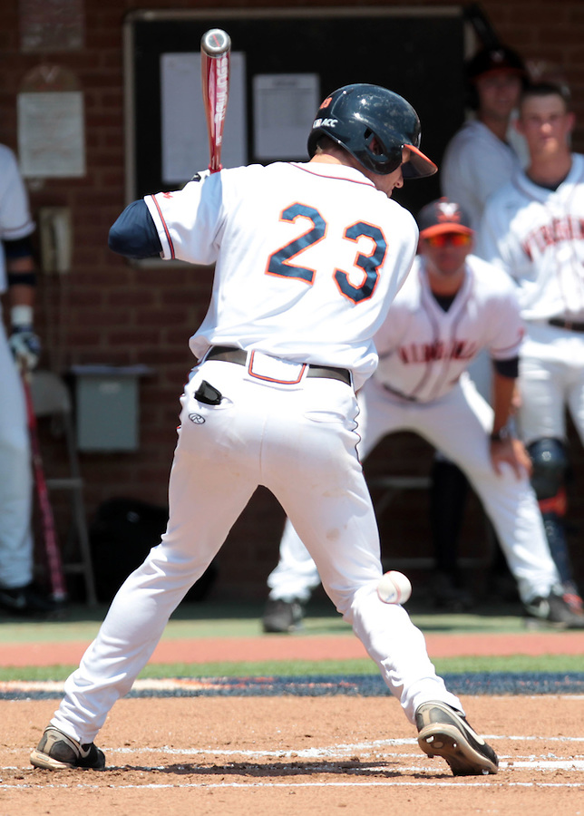 Virginia outfielder Derek Fisher (23) is hit by the ball in the first inning of an NCAA college baseball tournament super regional game against Maryland in Charlottesville, Va., Saturday, June 7, 2014. Maryland defeated Virginia 5-4. (AP Photo/Andrew Shurtleff)