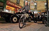 "The first (press) view of the new £74m Riverside Museum in Glasgow included the newly created 100-year old ""street"" scene - now expanded and with many more echoes of the past than the iconic version that attracted visitors to the old Transport Musuem - pic shows former World Cycling Champion Graeme Obree (some of his old bikes form part of the Museum collections) re-uniting with one of his modes of transport in the ""new"" street. The new museum will house over 300 exhibits and opens to the public on June 21 - 01.06.11 - 07702 319 738 - www.donald-macleod.com - clanmacleod@btinternet.com"