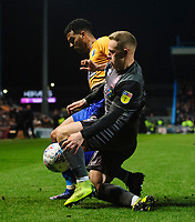 Lincoln City's Danny Rowe vies for possession with Mansfield Town's Jacob Mellis<br /> <br /> Photographer Chris Vaughan/CameraSport<br /> <br /> The EFL Sky Bet League Two - Mansfield Town v Lincoln City - Monday 18th March 2019 - Field Mill - Mansfield<br /> <br /> World Copyright © 2019 CameraSport. All rights reserved. 43 Linden Ave. Countesthorpe. Leicester. England. LE8 5PG - Tel: +44 (0) 116 277 4147 - admin@camerasport.com - www.camerasport.com