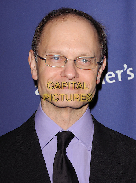 "DAVID HYDE PIERCE .at The 18th Annual ""A Night at Sardi's"" Fundraiser & Awards Dinner held at The Beverly Hilton Hotel in The Beverly Hills, California, USA, March 18th 2010..portrait headshot black tie glasses purple shirt                                                         .CAP/RKE/DVS.©DVS/RockinExposures/Capital Pictures."