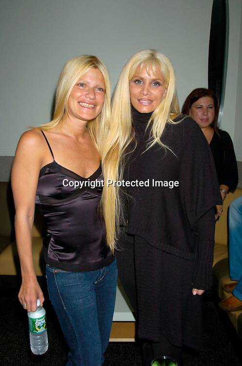 Lizzie Grubman and Victoria Gotti ..at the opening of new bar  17 on July 14, 2004 in New York City. John Enos is one of the owners. Lizzie Grubman was ..being filmed for a realty show on MTV...Photo by Robin Platzer, Twin Images..