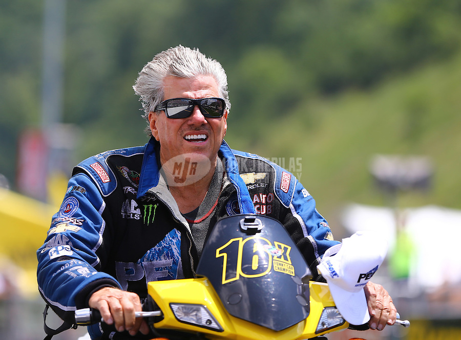 Jun 21, 2015; Bristol, TN, USA; NHRA funny car driver John Force on his scooter during the Thunder Valley Nationals at Bristol Dragway. Mandatory Credit: Mark J. Rebilas-