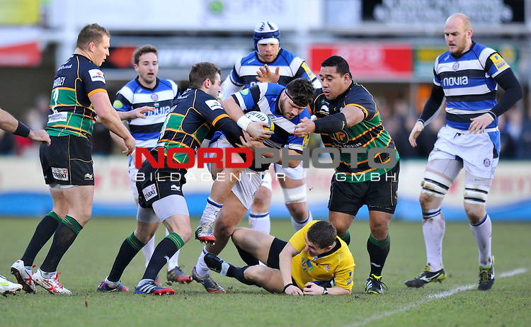 Referee Luke Pearce is knocked to the ground by Rob Webber (Bath) forcing him to sit out the rest of the match -  28/12/2013 - SPORT - RUGBY UNION -  Franklin's Gardens, Northampton - Northampton Saints v Bath - Aviva Premiership.<br /> Foto nph / Meredith<br /> <br /> ***** OUT OF UK *****