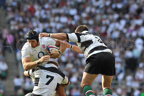 3./05.10    James Haskell of England is tackled by Martyn Williams and Ben Kay   during the Barbarians v England match onMay 30 at Twickenham Stadium, Middlesex. England won this special match by a score over the Barbarians of England 35 Barbarians 26