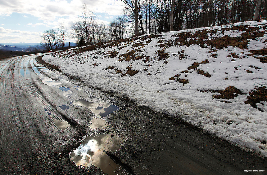 A dirt road leads to one of many sap collectors set up by the Morse Farm in Montpelier, VT, Tuesday, March 26, 2013.  (Cheryl Senter for the New York Times)