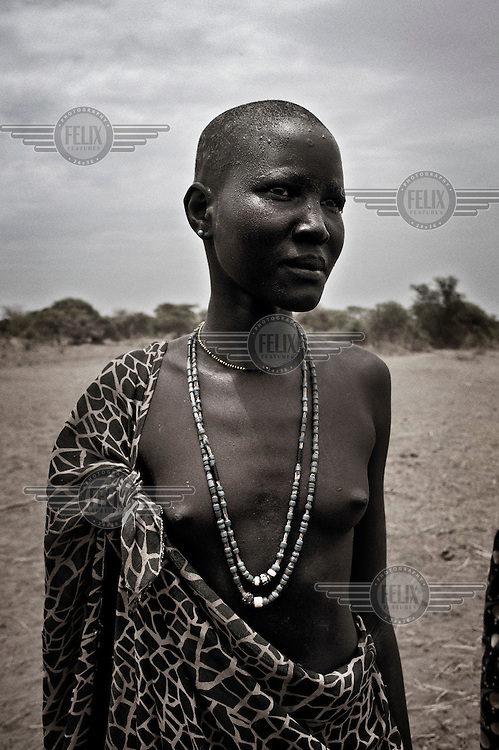 South Sudan. 23 March 2011...A young Dinka woman..