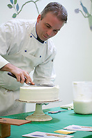 Baker, decorating a cake, New Jersey