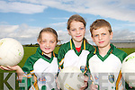 ON THE BALL: Future Kerry football stars from St. Senans and Finuge at the Kerry GAA VHI Cul Camp in Mountcoal on Thursday last..L/r.Aoife Hennessy, Ciara Galvin and Donal Hunt..