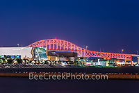 We took this of the Harbour Bridge and American Bank Center recently at night in Corpus Christi.  We could did not see clearly that there were terns all lined up on pier in front of the center all settling in for the night.