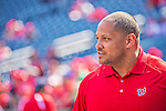 1 April 2013: Washington Nationals Director of Team Travel Rob McDonald watches batting practice prior to the Opening Day Game against the Miami Marlins at Nationals Park in Washington, DC. The Nationals shut out the Marlins 2-0 to launch the 2013 season. Mandatory Credit: Ed Wolfstein Photo *** RAW (NEF) Image File Available ***