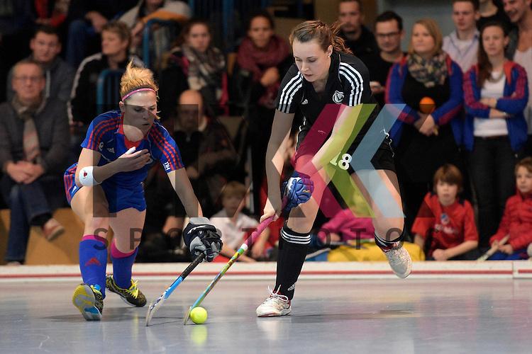 GER - Mannheim, Germany, January 30: During the 1. Bundesliga Damen indoor hockey quarter final match between Mannheimer HC (blue) and TuS Lichterfelde (black) on January 30, 2016 at Irma-Roechling-Halle in Mannheim, Germany.   Vera Battenberg #64 of Mannheimer HC, Aliki Korth #18 of TuS Lichterfelde<br /> <br /> Foto &copy; PIX-Sportfotos *** Foto ist honorarpflichtig! *** Auf Anfrage in hoeherer Qualitaet/Aufloesung. Belegexemplar erbeten. Veroeffentlichung ausschliesslich fuer journalistisch-publizistische Zwecke. For editorial use only.