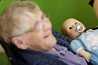 Pictured: Phylis Greening.  Thursday 12 December 2019<br /> Re: Realistic looking baby dolls used for therapy at the Oaklands Day Centre in Rhymney near Tredegar south Wales, UK.
