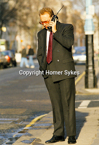 Business man using a Brick mobile phone 1980s Mayfair London UK