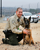 NWA Democrat-Gazette/DAVID GOTTSCHALK - 1/12/15 - Washington County Sheriff Corporal Taylor Reed with his service dog Coty Monday January 12, 2015 at the Washington County Sheriff's office in Fayetteville. Reed has returned to the department after being shot in the line of duty in August.