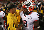 30 August 2008:   Missouri head coach Gary Pinkel visits with Illinois player Arrelious Benn (9) after the 2008 State Farm Arch Rivalry game which was played at the Edward Jones Dome in St. Louis, Missouri, August 30, 2008 with the Missouri Tigers coming into the game ranked 6th in the nation and The Fighting Illini ranked 20th.  Missouri defeated Illinois, 52-42.