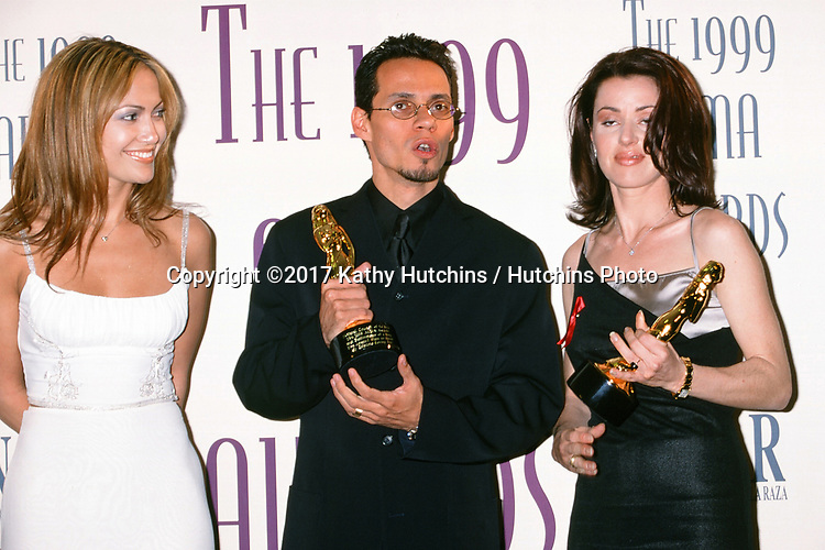 LOS ANGELES - APR 11:  Jennifer Lopez, Marc Anthony, Dayanara Torres at the Fourth Annual ALMA Awards at the Pasadena Civic Auditorium on April 11, 1999 in Pasadena, CA