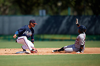 Atlanta Braves Derian Cruz (4) can not come up with the throw as Dawel Lugo (71) slides safely into second base during an Instructional League game against the Detroit Tigers on October 10, 2017 at the ESPN Wide World of Sports Complex in Orlando, Florida.  (Mike Janes/Four Seam Images)