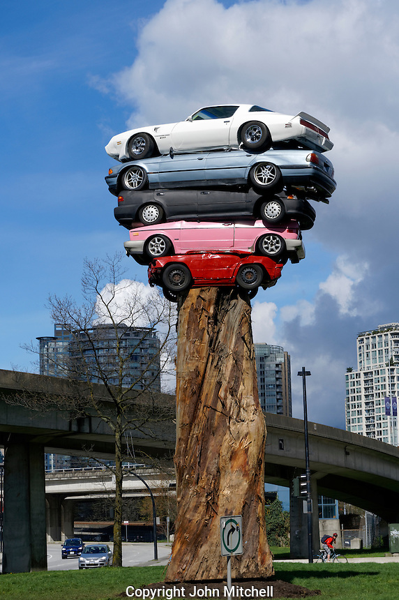 A new public art installation entitled Trans Am Totem in Vancouver, British Columbia. This playful sculpture created by Vancouver artist Marcus Bowcott consists of five recycled cars placed on top of the trunk of an old-growth cedar tree.