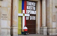 BOGOTA, COLOMBIA - APRIL 12: A man knees down to commemorate Easter Sunday, in front of a closed church due to the spread of COVID-19 in Bogota, on April 12, 2020. Colombian Catholic authorities decided to close all churches and temples during the holy week to avoid the spread of coronavirus in the country that took more than 100 lives already. (Photo by Daniel Munoz/VIEWpress)
