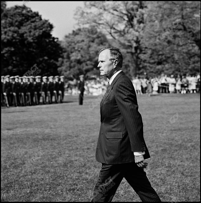 US President George H. W. Bush on the White House lawn on his way to greet President Carlos Perez of Venezuela. Washington DC, USA, May 1990