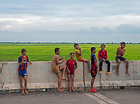 Teenagers having fun on the weekend on the road between Siem Reap and Battambang the agriculture region of Cambodia