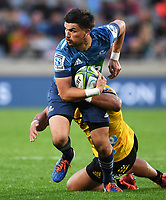 14th June 2020, Aukland, New Zealand;  Otere Black is tackled  at the Investec Super Rugby Aotearoa match, between the Blues and Hurricanes held at Eden Park, Auckland, New Zealand.