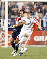 Vancouver Whitecaps FC defender Jordan Harvey (3) works to bring ball out as New England Revolution forward Benny Feilhaber (22) defends. In a Major League Soccer (MLS) match, the New England Revolution defeated Vancouver Whitecaps FC, 4-1, at Gillette Stadium on May 12, 2012.
