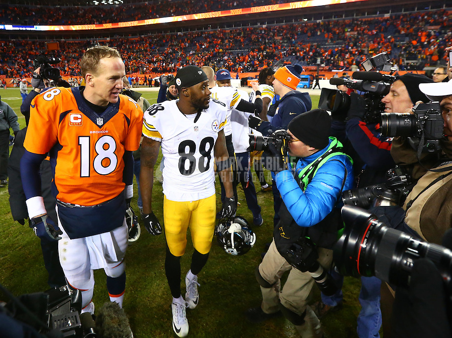 Jan 17, 2016; Denver, CO, USA; Denver Broncos quarterback Peyton Manning (18) greets Pittsburgh Steelers wide receiver Darrius Heyward-Bey (88) following the AFC Divisional round playoff game at Sports Authority Field at Mile High. Mandatory Credit: Mark J. Rebilas-USA TODAY Sports