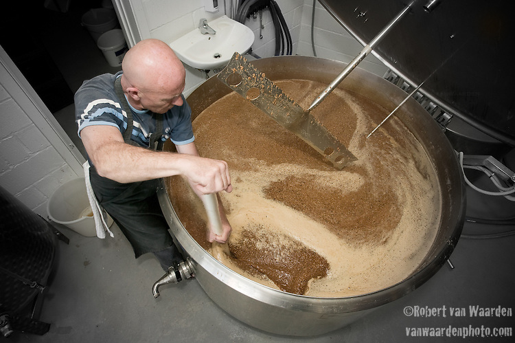 Brewmaster Tommy demonstrates the key to a great beer, a gentle manual stir and plenty of elbow grease. This small brewery in Raervig, Denmark is a new brewery on the competitive scene of micro brewers in Europe.