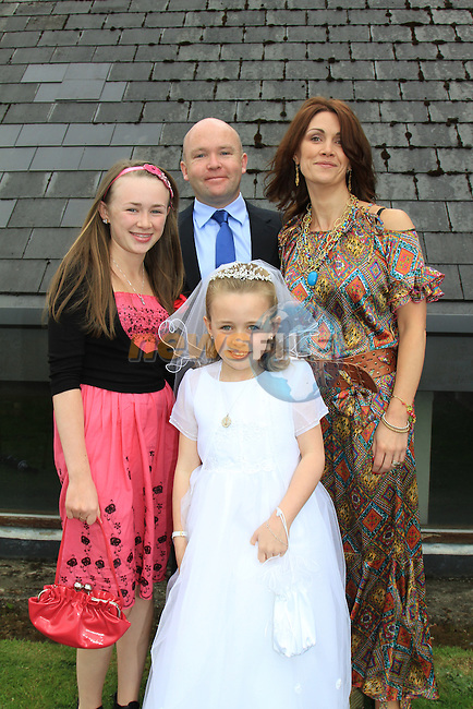 Penny Flood, Sister Emily and Parents Richie and Trish..First Communion inn Whitecross Church, Julianstown..Picture Fran Caffrey/Newsfile.ie