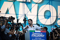 """Matteo Salvini (Leader of the Lega/League, former Deputy Prime Minister & Minister of the Interior of Italy) tells lens journalists to leave the stage.<br /> <br /> Rome, 19/10/2019. Today, tens thousands of people (200,000 for the organisers, 50,000 for the police) gathered in Piazza San Giovanni to attend the national demonstration """"Orgoglio Italiano"""" (Italian Pride) of the far-right party Lega (League) of Matteo Salvini. The demonstration was supported by Silvio Berlusconi's party Forza Italia and Giorgia Meloni's party Fratelli d'Italia (Brothers of Italy, right-wing).  <br /> The aim of the rally was to protest against the Italian coalition Government (AKA Governo Conte II, Conte's Second Government, Governo Giallo-Rosso, 1.) lead by Professor Giuseppe Conte. The 66th Government of Italy is a coalition between Five Star Movement (M5S, 2.), Democratic Party (PD – Center Left, 3.), and Liberi e Uguali (LeU – Left, 4.), these last two parties replaced Lega / League as new members of a coalition based on Parliamentarian majority as stated in the Italian Constitution. The Governo Conte I (Conte's First Government, 5.) was 14-month-old when, between 8 and 9 of August 2019, collapsed after the Interior Minister Matteo Salvini withdrew his euroskeptic, anti-migrant, right-wing Lega / League (6.) from the populist coalition in a pindaric attempt (miserably failed) to trigger a snap election.<br /> <br /> Footnotes & Links:<br /> 1. http://bit.do/feK6N<br /> 2. http://bit.do/e7JLx<br /> 3. http://bit.do/e7JKy<br /> 4. http://bit.do/e7JMP<br /> 5. http://bit.do/e7JH7<br /> 6. http://bit.do/eE7Ey<br /> https://www.leganord.org<br /> http://bit.do/feK9X (Source, TheGuardian.com)<br /> Reportage: """"La Fabbrica Della Paura"""" (The Factory of Fear): http://bit.do/feLcy (Source Report, Rai.it - ITA)<br /> (Update) Reportage: """"La Fabbrica Social Della Paura"""" (The Social Network Factory of Fear): http://bit.do/fe8Pn (Source Report, Rai.it - ITA)"""