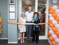 Mandy Boesche cuts the ribbon to Johnson Hall classroom 303, the Roger Boesche Classroom, with Wendy Sternberg, Vice President for Academic Affairs and Dean of the College and President Jonathan Veitch looking on.<br /> Friends, family, alumni, students, faculty and staff gather in Johnson Hall classroom 303 for the dedication of The Roger Boesche Classroom on Oct. 21, 2018. The dedication included a ribbon cutting. The gathering then went downstairs to the McKinnon Center for Global Affairs to watch a video of daughter Kelsey Boesche and to listen to remarks.<br /> Longtime Occidental College politics professor Roger Boesche, revered by generations of Oxy students and credited by President Barack Obama '83 for sparking his interest in politics, passed away on May 23, 2017.<br /> (Photo by Marc Campos, Occidental College Photographer)