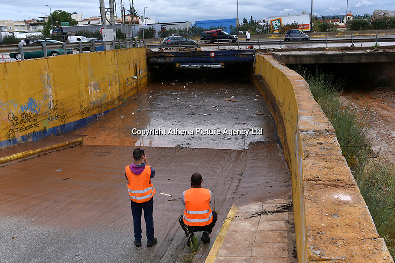 Pictured: A flooded road on the Athens to Corinth motorway in the outskirts of Athens, Greece. Wednesday 27 June 2018<br /> Re: Flashflooding has been caused by storm Nefeli in parts of Greece.