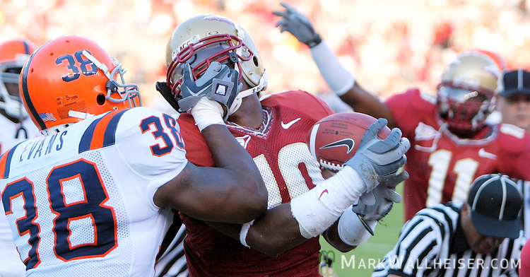 Tempers flared for Syracuse Breyone Evans (38) after Florida State linebacker Geno Hayes recovered a Syracuse fumble in their 38-14 defeat of Syracuse in Tallahassee, Florida October 1, 2005.  Florida State's Gerald Ross (11) signals the recovery in the background.