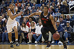 San Diego State forward Matt Mitchell  (11) drives past Nevada forward Robby Robinson (1) during the first half of a basketball game played at Lawlor Events Center in Reno, Nev., Saturday, Feb. 29, 2020. (AP Photo/Tom R. Smedes)