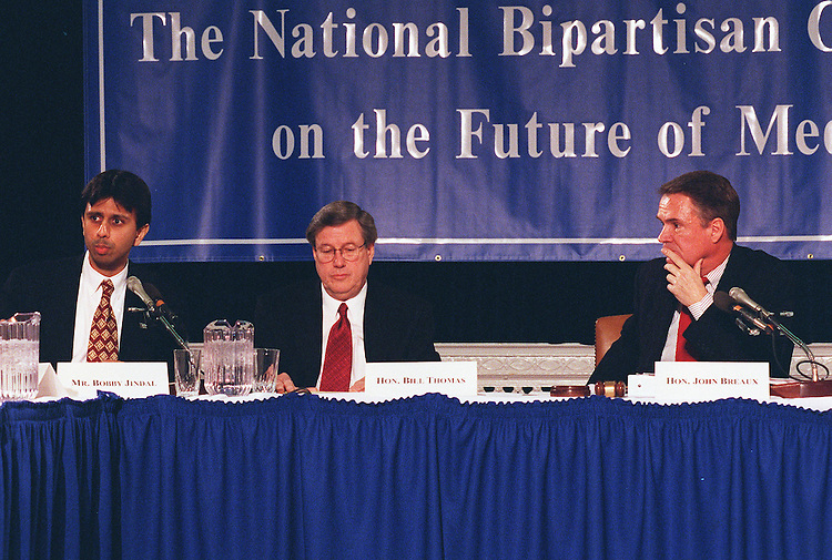 3/6/98.MEDICARE COMMISSION--Bobby Jindal executive director,Chairman Bill Thomas,R-Calif., and John B. Breaux,D-La.,listen to opening statements at the first meeting of the National Commission on the Future of Medicare..CONGRESSIONAL QUARTERLY PHOTO BY DOUGLAS GRAHAM