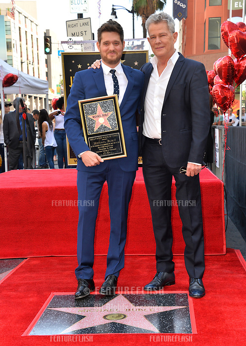 LOS ANGELES, CA. November 16, 2018: Michael Buble &amp; David Foster at the Hollywood Walk of Fame Star Ceremony honoring singer Michael Bubl&eacute;.<br /> Pictures: Paul Smith/Featureflash