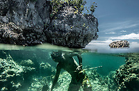 Marjono Lessing searches for lobsters in holes in the rock near Kabalutan, Indonesia. Bajau fishermen like Lessing make full use of what the sea has to offer, havesting fish, octopus, shellfish, lobster and sea-cucumbers among others. (Photo: Aurélie Marrier d'Unienville)