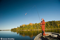 Fisherman fishing for musky from his fishing boat on a sunny day