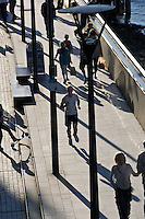 Pedestrians and jogger on Thames Path, London, England, United Kingdom