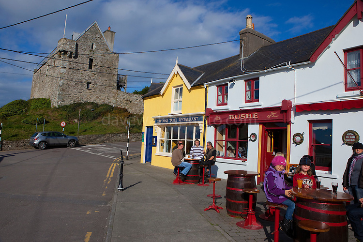 People outside Bushe's Bar in The fishing village of Baltimore, West Cork, Ireland